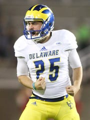 Delaware placekicker Frank Raggo exalts in his 50-yard strike in the third quarter of the Blue Hens' 24-20 win at LaValle Stadium Saturday.