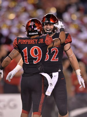 San Diego State tight end Parker Houston, right, celebrates with Donnel Pumphrey after a touchdown earlier this season. Houston is a Reed High graduate who will play at Nevada on Saturday.
