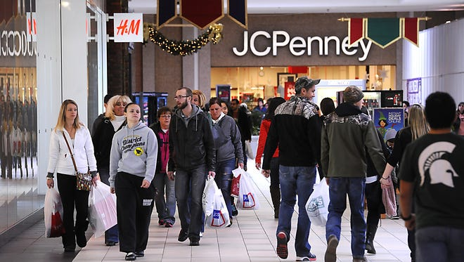 Shoppers crowd the Meridian Mall on Black Friday in 2014 in Meridian Township. The mall will be closed on Thanksgiving this year despite being open in past years.