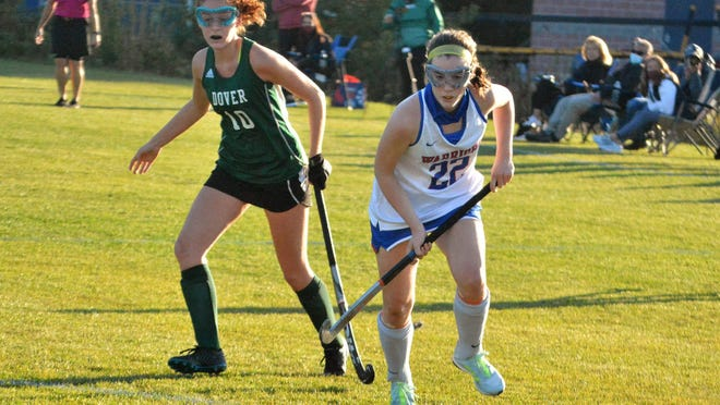 Winnacunnet High School's Abby Wilber, right, and Dover's Meghan Fitzgerald chase after the ball during the second half of their Division I field hockey game in Hampton on Oct 5.