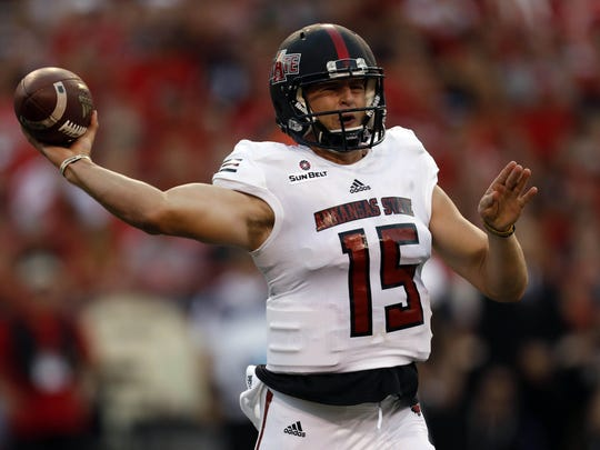 Arkansas State Red Wolves quarterback Justice Hansen (15) throws against the Nebraska Cornhuskers at Memorial Stadium in Lincoln on Sept. 2, 2017.