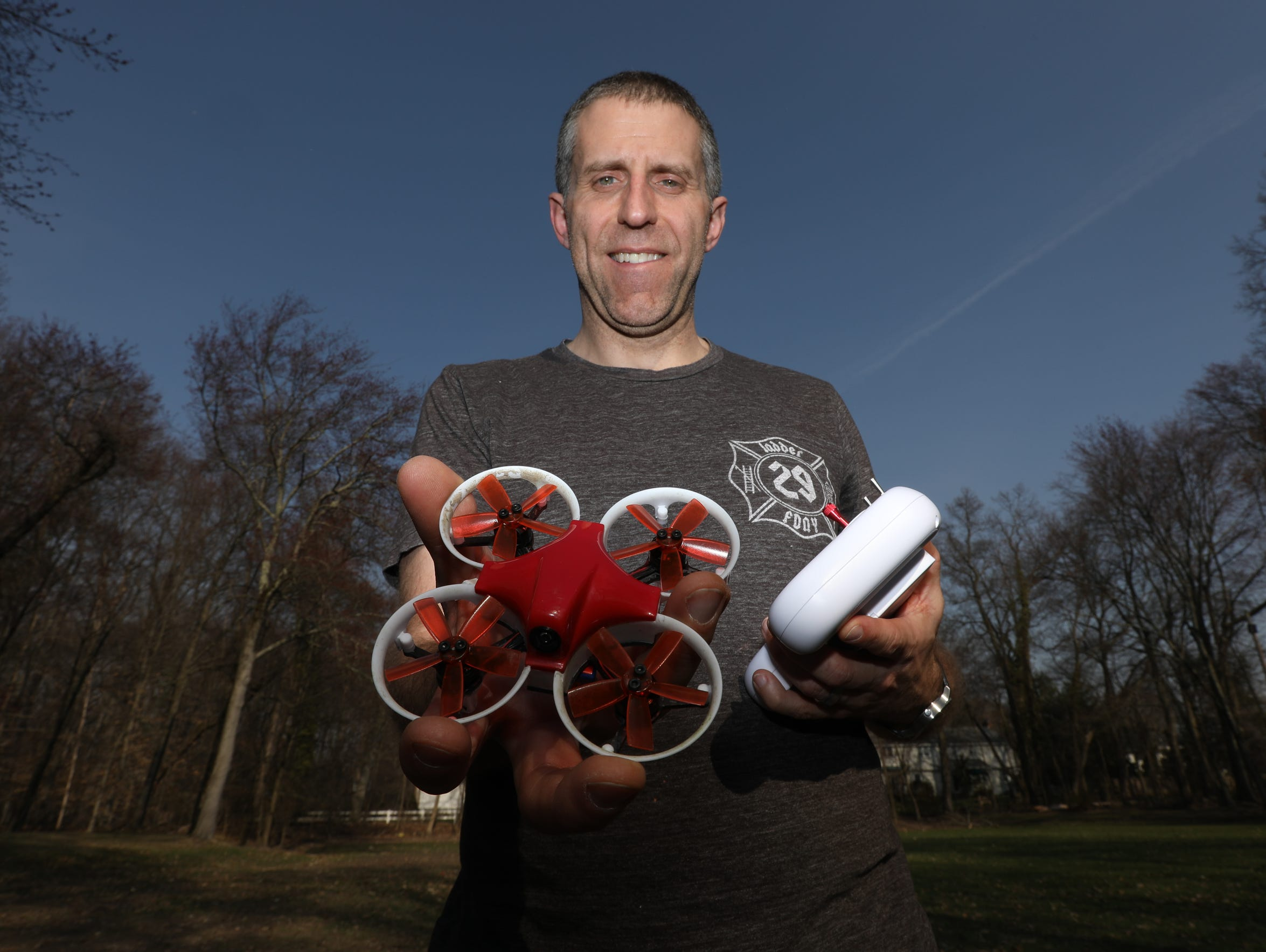 Vinny Garrison with a racing drone like the ones his