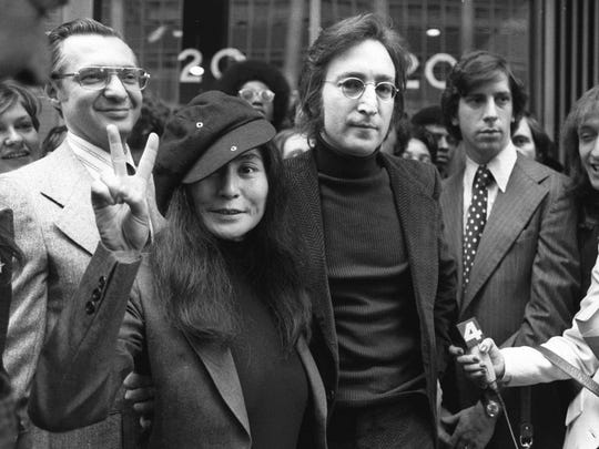In this April 18, 1972 file photo, John Lennon and his wife, Yoko Ono, leave a U.S. Immigration hearing in New York City. Mark David Chapman shot and killed Lennon on Dec. 8, 1980.