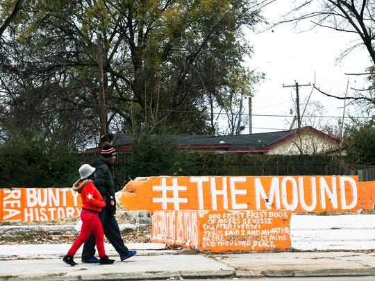 A couple passes a mural in Orange Mound on Park Ave. on Friday morning. First Lady Michelle Obama designated Orange Mound, the nation's first subdivision developed for African-Americans to purchase land and build their own homes, as a Preserve America Community.