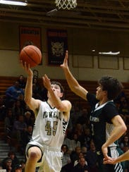Howell's Nick Tholen drives to the basket against Williamston's
