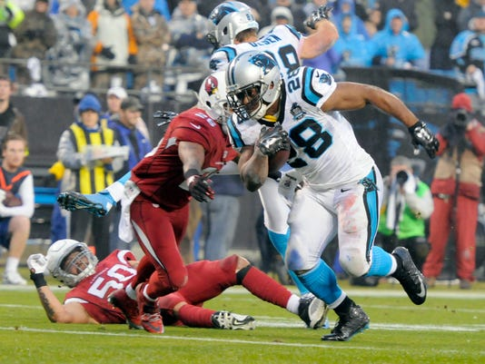 Carolina Panthers' Jonathan Stewart (28) runs past Arizona Cardinals' Rashad Johnson (26) for a touchdown in the first half of an NFL wild card playoff football game in Charlotte, N.C., Saturday, Jan. 3, 2015. (AP Photo/Mike McCarn)