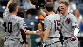 Mississippi State designated hitter Jordan Westburg, right, celebrates his grand slam with Jake Mangum (15) and teammates in the second inning of an NCAA College World Series baseball game against North Carolina in Omaha, Neb., Tuesday, June 19, 2018.