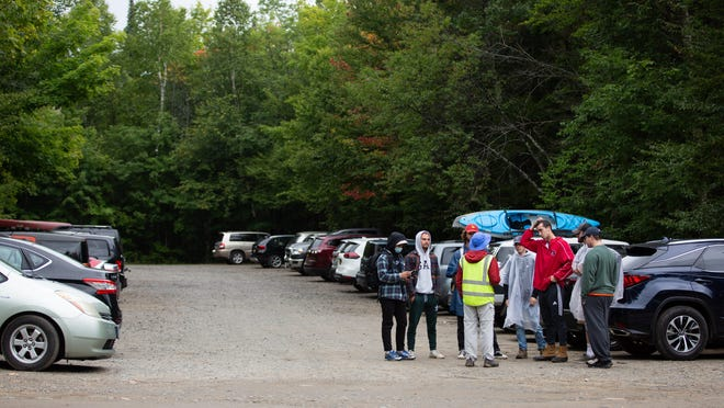 Stu Weinberg, wearing a reflective vest, talks to a group of young men who were planning to hike Mount Marcy on Saturday, Aug. 29, 2020.