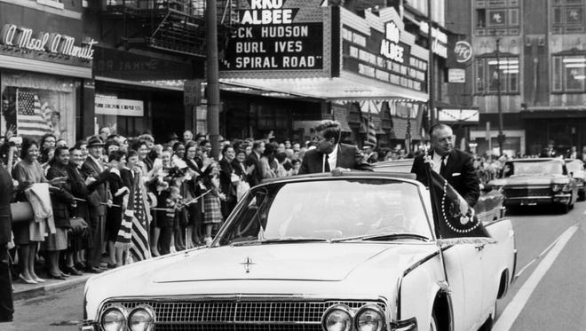 President John F. Kennedy rides with Ohio Gov. Michael DiSalle in a motorcade along Fifth Street on Oct. 5, 1962.