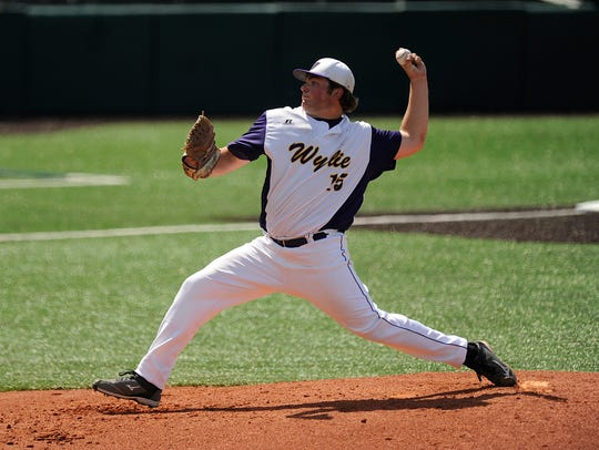 Wylie's Connor Carlton (15) throws a pitch during the