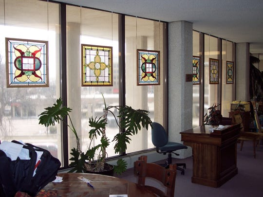 These stained glass panels, now hanging in the Montana