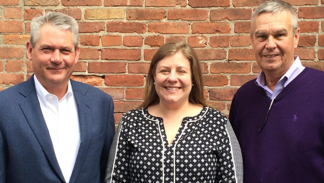 From left: Bill Millard, Meredith Rietz and Chris Williams of the Christopher Williams Insurance Agency.