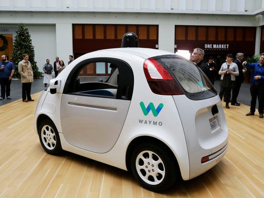 The Waymo driverless car is displayed during a Google