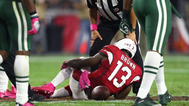 Arizona Cardinals wide receiver Jaron Brown (13) reacts after suffering an injury against the New York Jets on Oct. 16, 2016, at University of Phoenix Stadium.