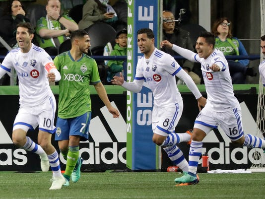 Montreal Impact forward Jeisson Vargas, second from right, celebrates with teammates after he scored a goal against the Seattle Sounders with an assist from Ignacio Piatti, left, during the second half of an MLS soccer match, Saturday, March 31, 2018, in Seattle. The Impact won 1-0. (AP Photo/Ted S. Warren)