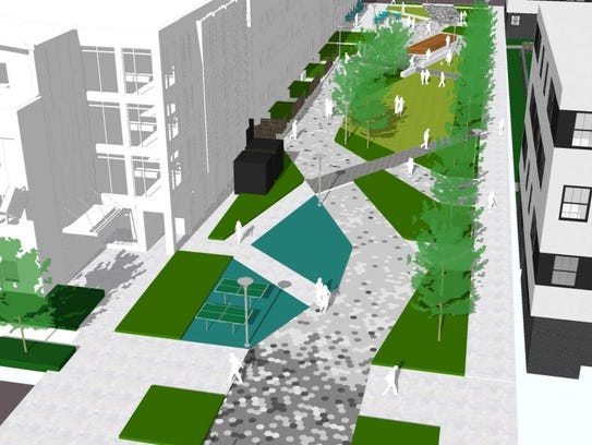 A pedestrian plaza is proposed between two apartment