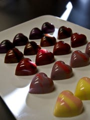 These are a few of the exclusive chocolate flavors available from Norman Love Confections from Feb. 2-14. A total of 10 distinct flavors will be available including: Rum Rampage, Savage Spice, Wild Fire, Peanut Butter Purr, Berry Fierce, Passion Orange, Sweet Stampede, Caramel Banana Bite, Cool Congo and Dark Cherry Charge.