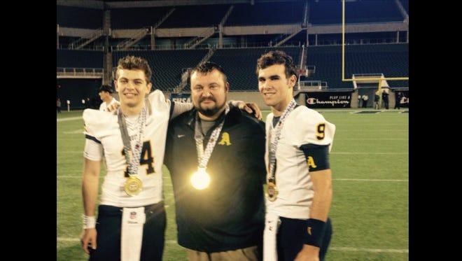 New Cocoa head football coach Ryan Schneider (center) was the offensive coordinator for two state championship teams at St. Thomas Aquinas.