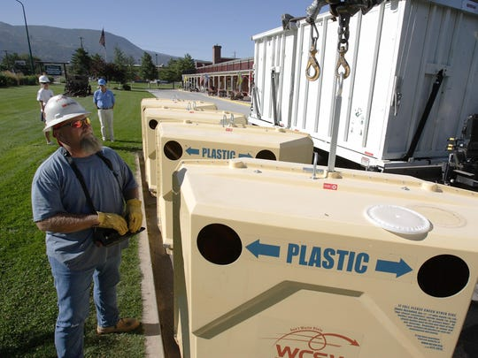Brian Wilson with the Washington County Solid Waste District operates a recycling pickup truck in this Spectrum Media file photo. Local communities are planning to implement a new curbside recycling program by early 2016.
