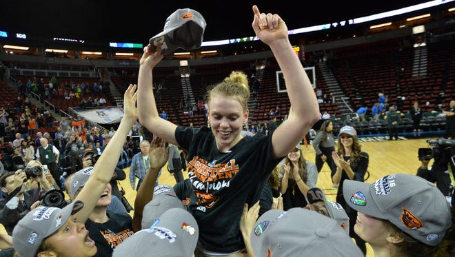 Mar 6, 2016; Seattle , WA, USA; Oregon State guard Jamie Weisner is hoisted by teammates after being selected as the most valuable player of the Pac-12 Conference womens tournament at KeyArena. Oregon State defeated UCLA 69-57 to win the school's first conference tournament title.