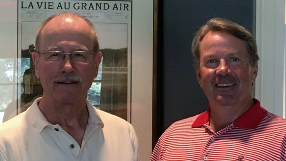 Rick Powers (left) went looking for the story behind St. Andrew's member Charles Sands, who won the first Olympic medal in golf, at the urging of club president George Miller (right).