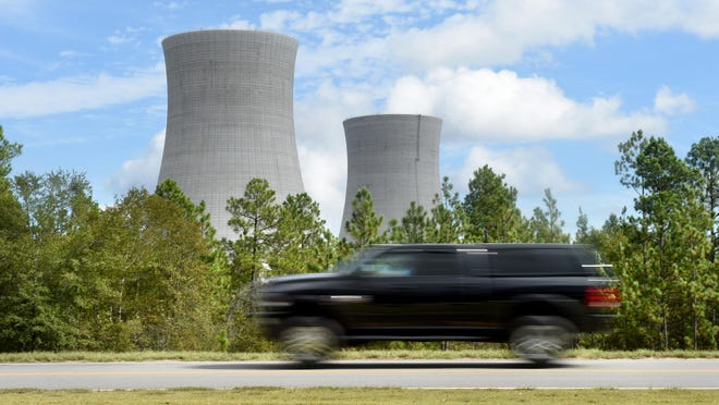 FILE - A car passes by Plant Vogtle on River Road in Waynesboro, Ga., Tuesday afternoon October 22, 2019.