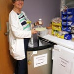Nancy Travis, Director of Women's Care Birth Suites at Cape Coral Hospital, stores a patient's breast milk. Donors to non-profit breast milk banks provide life-saving milk to babies in need.
