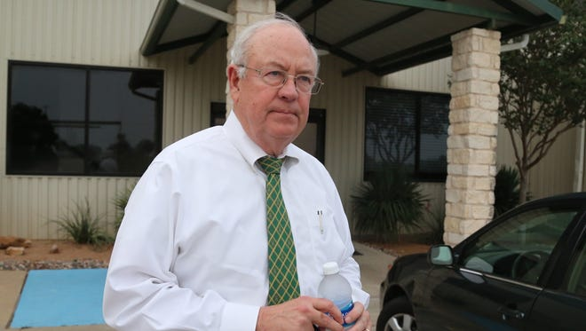 Baylor President Ken Starr leaves an airport terminal in Waco, Texas. Baylor University's Board of Regents says it will fire football coach Art Briles and re-assign Starr in response to questions about its handling of sexual assault complaints against players.