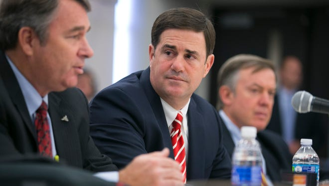 APRIL 9: Mark Killian, (left) then-chair of the Arizona Board of Regents, speaks months before Ducey tapped him to lead the Department of Agriculture. The governor says he put a lot of thought into the people he wanted leading state agencies and considers them a point of pride.
