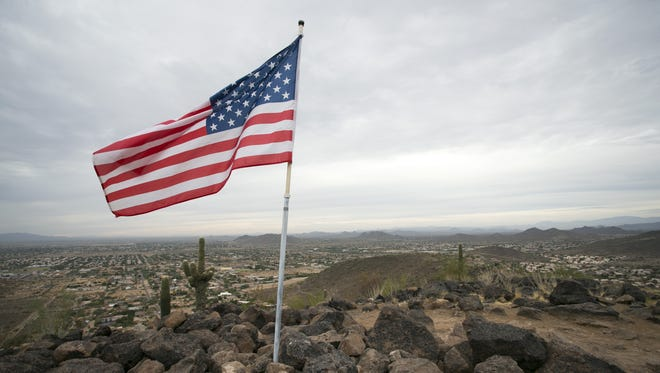 An American Flag along the top of hill on the Cholla Loop Trail in the Glendale Thunderbird Conservation Park on November 17, 2017.