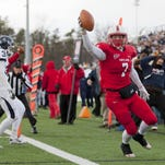 """SUNY Cortland's Jon Mannix celebrates after catching the winning touchdown pass as time expired in last year's 23-20 """"Cortaca"""" Jug victory over Ithaca in Cortland. This year's game, set for Nov. 14 at Butterfield Stadium, is one of four at IC that will double as #ShedTheRed clothing-drive benefits."""