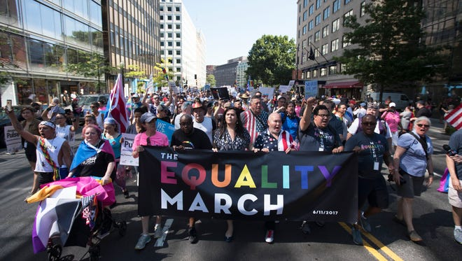 The front of the Equality March for Unity and Pride moves down 17th Street NW toward the White House in Washington, Sunday, June 11, 2017.