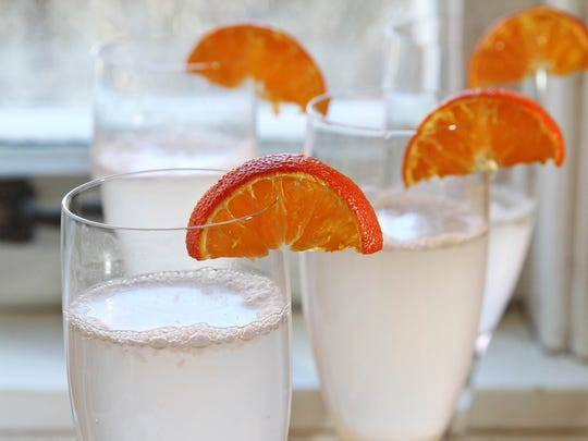 Grapefruit mimosas are garnished with kumquats or oranges.
