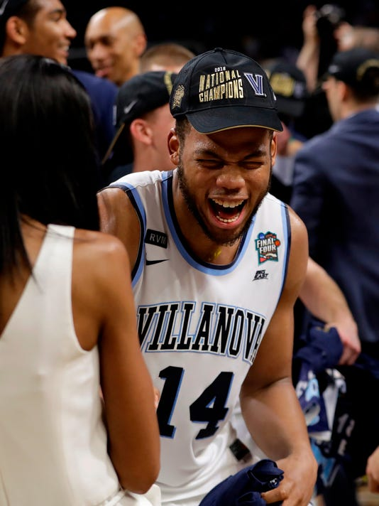 Villanova forward Omari Spellman celebrates on the court after beating Michigan 79-62 in the championship game of the Final Four NCAA college basketball tournament, Monday, April 2, 2018, in San Antonio. (AP Photo/Eric Gay)