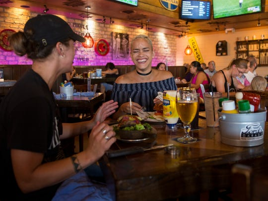 Stephanie Torres, left, and Barbara Rojas eat at Ford's Garage on Thursday, June 29, 2017. Miromar Outlets will not be having fireworks this year due to construction in the area where the fireworks typically launch.