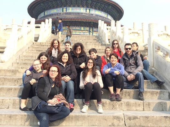 The group poses on the steps of the Temple of Heaven