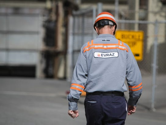 An employee enters the west gate of Claymont Steel