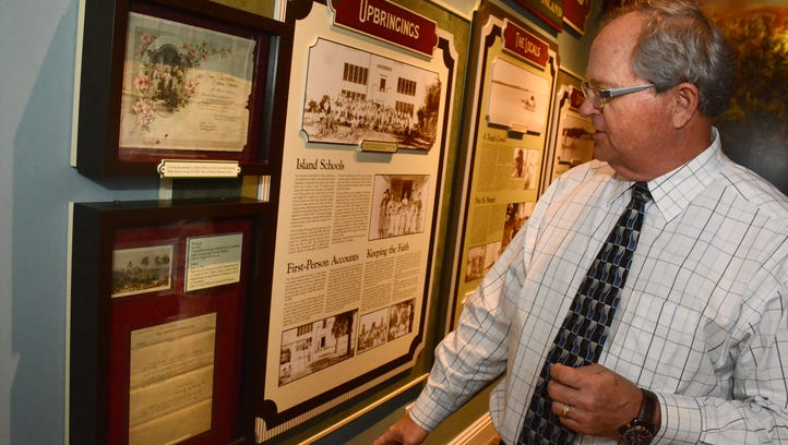 Local historian and attorney Craig Woodward shows some