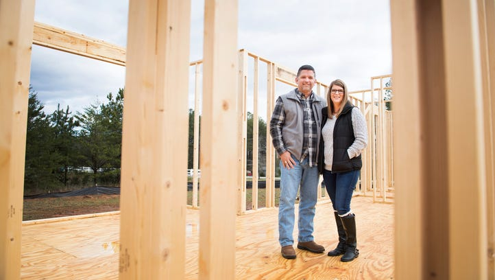 Chad and Melissa Albertson stand in one of the homes that is being built for foster children at LIFEhouse Church in Easley on Tuesday, March 14, 2017.