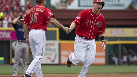 Reds third baseman Todd Frazier is congratulated by