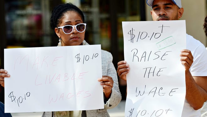 Delores Minaya, left, and Julio Rodriguez, both of York City, represent the NAACP in support of raising the minimum wage to $10.10 per hour during a press conference held at Continental Square in York City, Thursday, March 24, 2016. Dawn J. Sagert photo