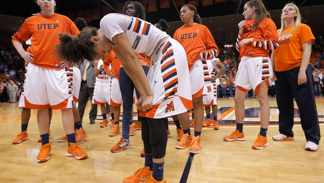 UTEP's Cameasha Turner doubles over in tears after the Miners lost their WNIT quarterfinal game against Oregon 71-67 Monday at the Don Haskins Center.