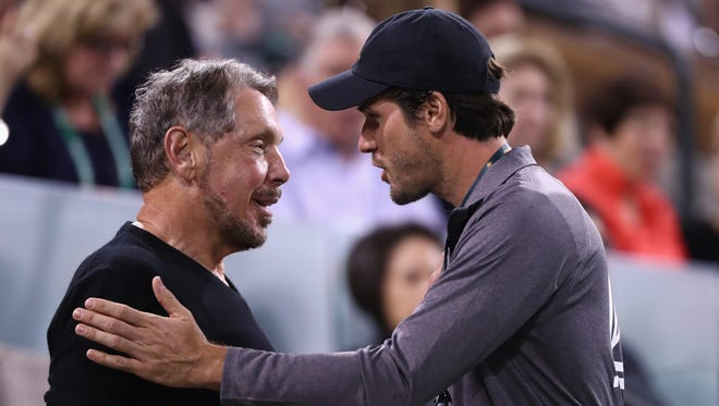 Larry Ellison talks with Tommy Haas during day four of the 2016 BNP Paribas Open at Indian Wells Tennis Garden/