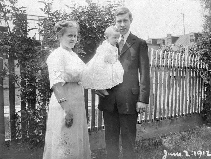A 1-year-old Ambrose LeVan with his parents in 1912.