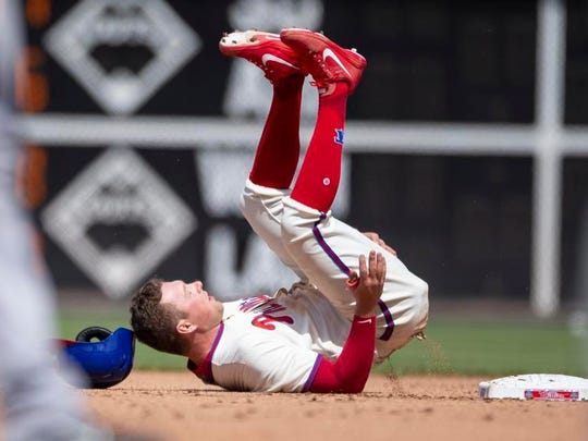 Philadelphia Phillies' Rhys Hoskins is out on an attempt