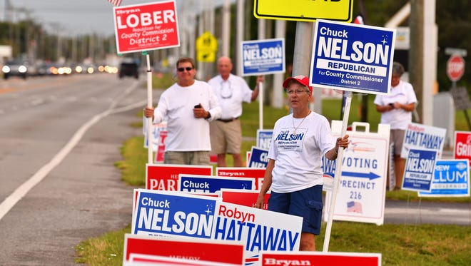 Candidates and supporters were out early Tuesday at the River of Life Church on Merritt Island waving signs and waving to voters.