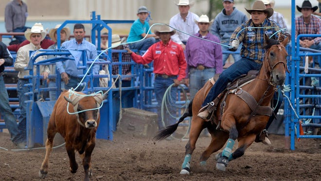 Erich Rogers and Cory Petska compete in the team roping event during the Big Sky Pro Rodeo at the Montana State Fair Wednesday evening.