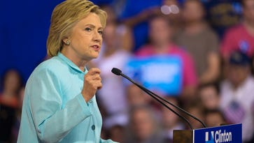 Hillary Clinton speaks at a campaign rally at Florida International University in Miami on July, 23, 2016. The rally was the first public appearance of Sen. Tim Kaine after being named Clinton's running mate.