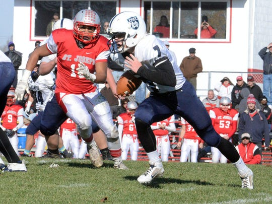 Mater Dei's Christian Palmer runs the ball against St. Joseph during Saturday's playoff game in Hammonton.