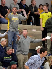 Sheboygan Christian fans are bewildered at a referee call during action with Howards Grove Thursday February 18, 2016 at Howards.